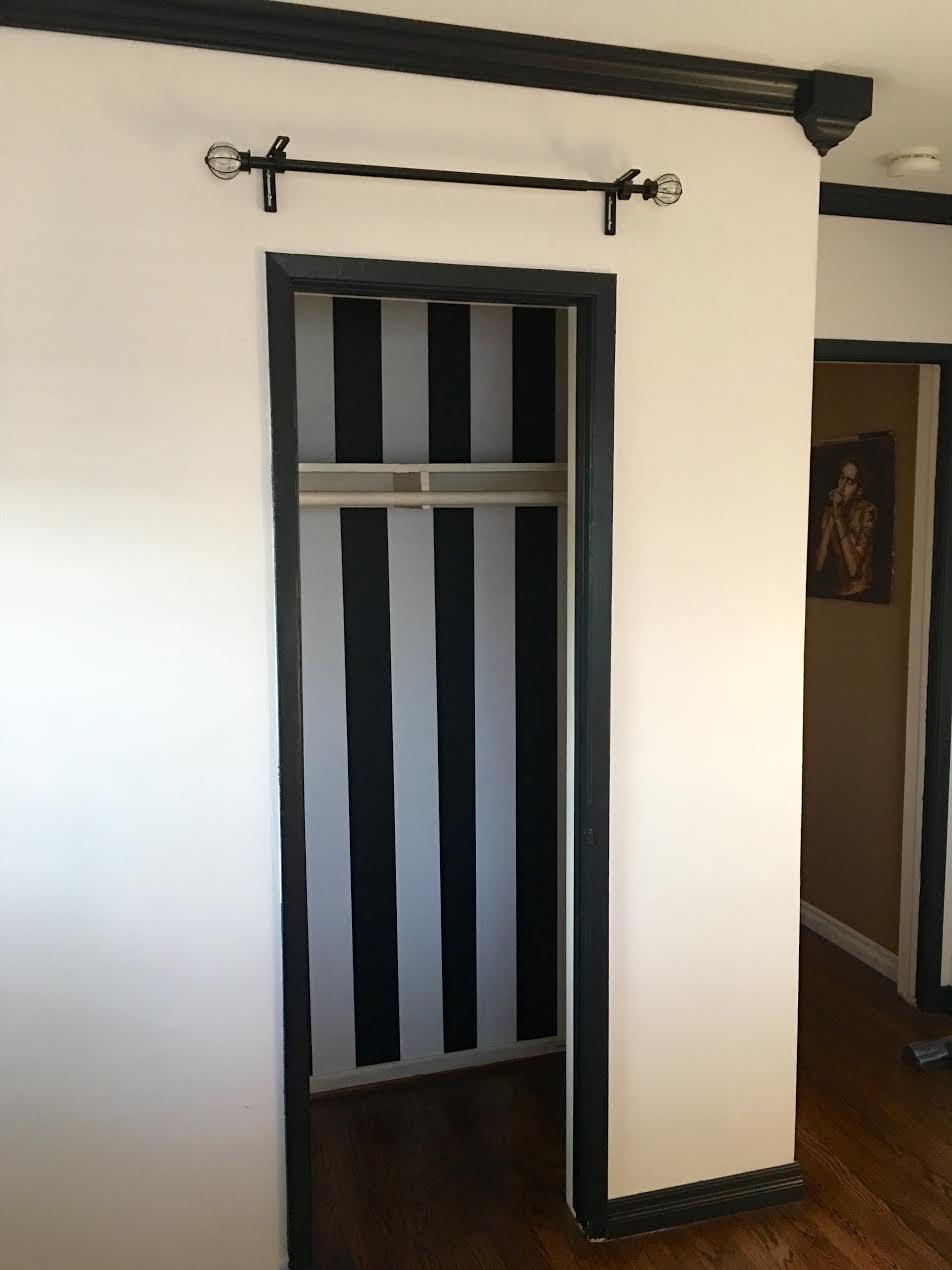 stripe-wallpaper-inside-closet-before-paint-emily-meritt-pottery-barn-teen-room-makeover • TheJetSetFamily